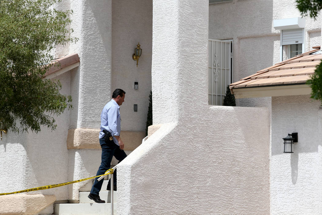 Las Vegas police investigate a homicide in a gated community near near North Durango and West G ...