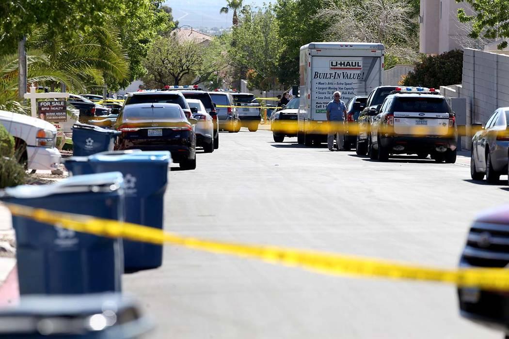 Las Vegas police investigate a shooting in 8500 block of Honey Vine Avenue, near North Durango ...