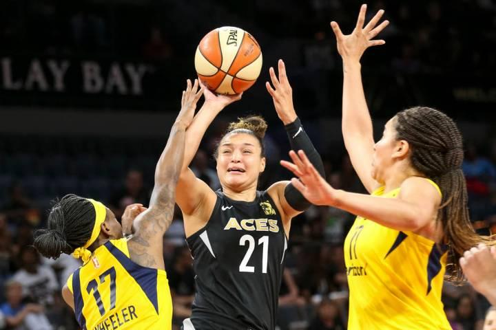 Las Vegas Aces guard Kayla McBride (21) takes a shot through Indiana Fever guard Erica Wheeler ...