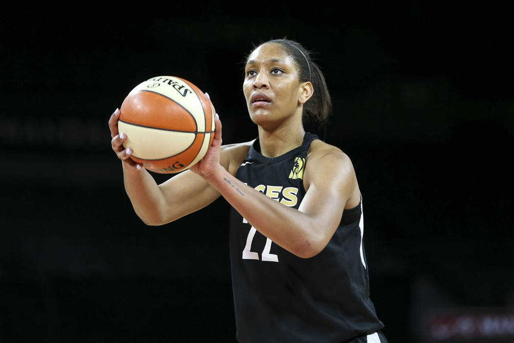 Las Vegas Aces center A'ja Wilson (22) shoots a free throw against the Los Angeles Sparks in th ...