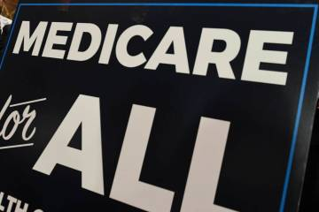 "A sign is shown during a news conference April 10, 2019, to reintroduce ""Medicare for All"" leg ..."