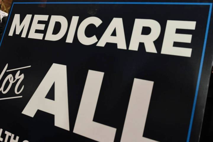 """A sign is shown during a news conference April 10, 2019, to reintroduce """"Medicare for All"""" leg ..."""