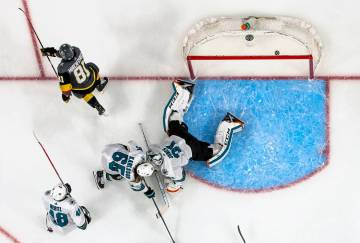 Golden Knights center Jonathan Marchessault (81) scores on San Jose Sharks goaltender Martin Jo ...