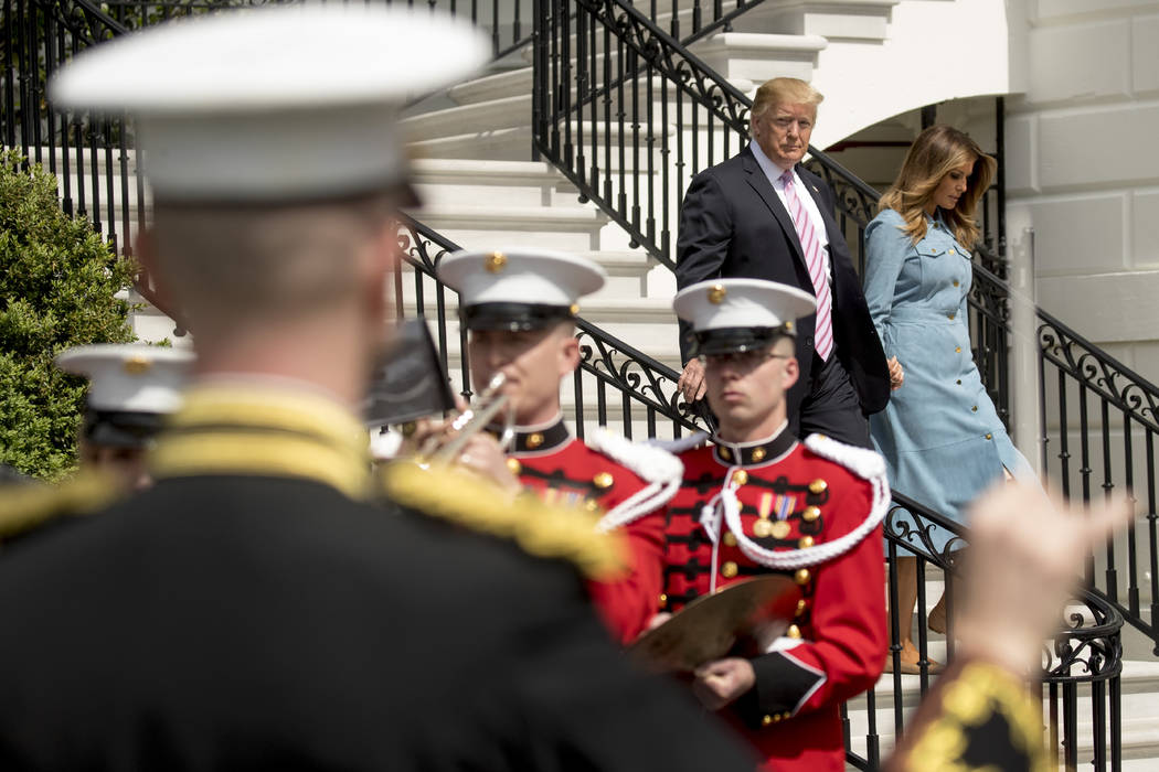 President Donald Trump and first lady Melania Trump arrive for the annual White House Easter Eg ...