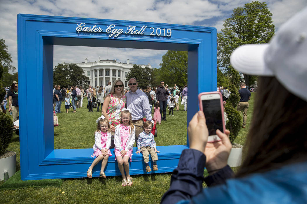 Guests take photos at the annual White House Easter Egg Roll on the South Lawn of the White Hou ...