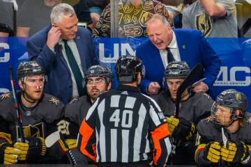 Golden Knights Head Coach Gerard Gallant argues a point with a referee during the first period ...