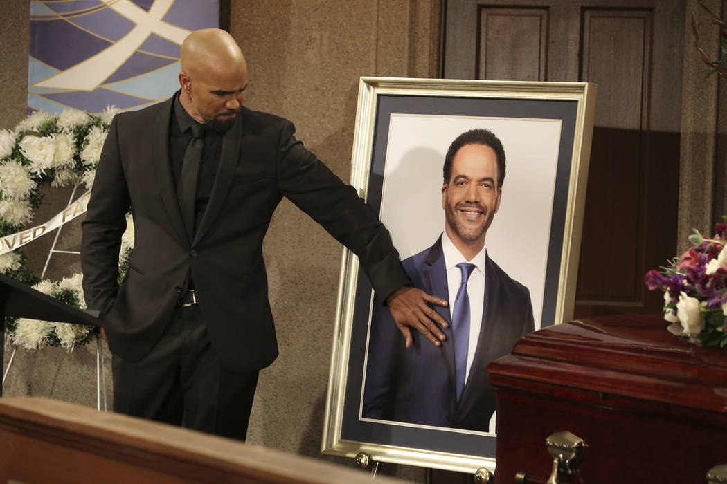 This image released by CBS shows Shemar Moore portraying Malcolm Winters during a funeral scene ...