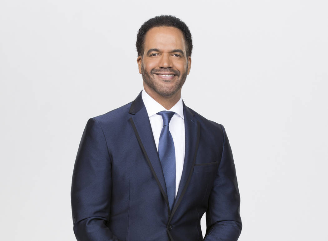 This image released by CBS shows Kristoff St. John who portrays Neil Winters on the CBS series ...