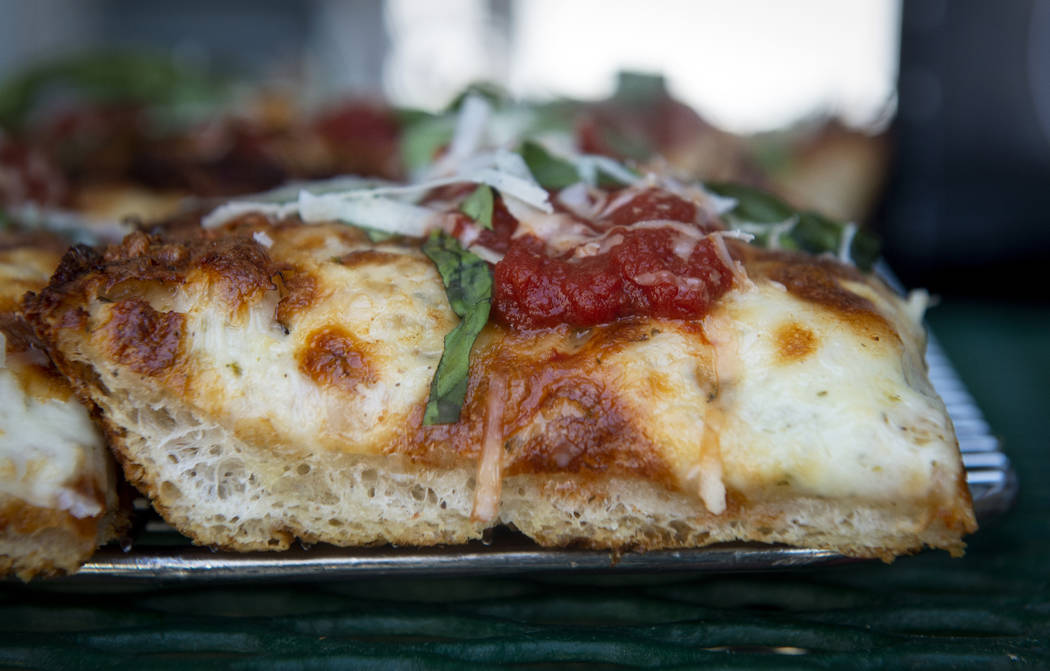 A gluten-free slice of Detroit-style cheese pizza sits out at Good Pie at Pawn Plaza in Las Veg ...