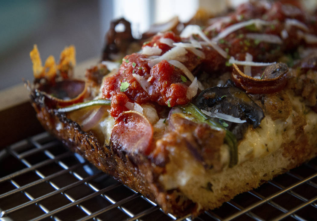 A slice of gluten-free Detroit supreme pizza, also known as the Diana Ross, sits out at Good Pi ...
