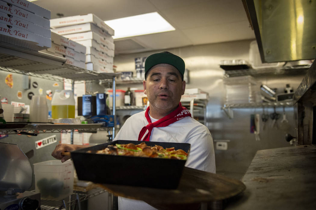 Vincent Rotolo takes out a gluten-free pie at Good Pie at Pawn Plaza in Las Vegas, Thursday, Ap ...