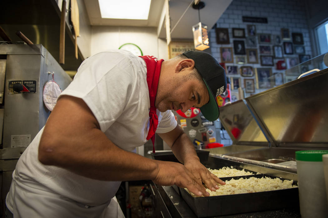 Vincent Rotolo prepares Detriot-style pizzas at Good Pie at Pawn Plaza in Las Vegas, Thursday, ...