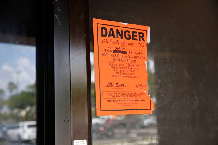 An orange danger sign is seen posted outside on the front entrance of the Orchids of Asia Day S ...