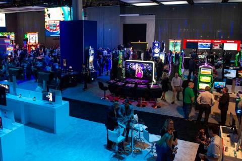 Scientific Games showcases their new games and technology behind a wall surrounding the booth t ...