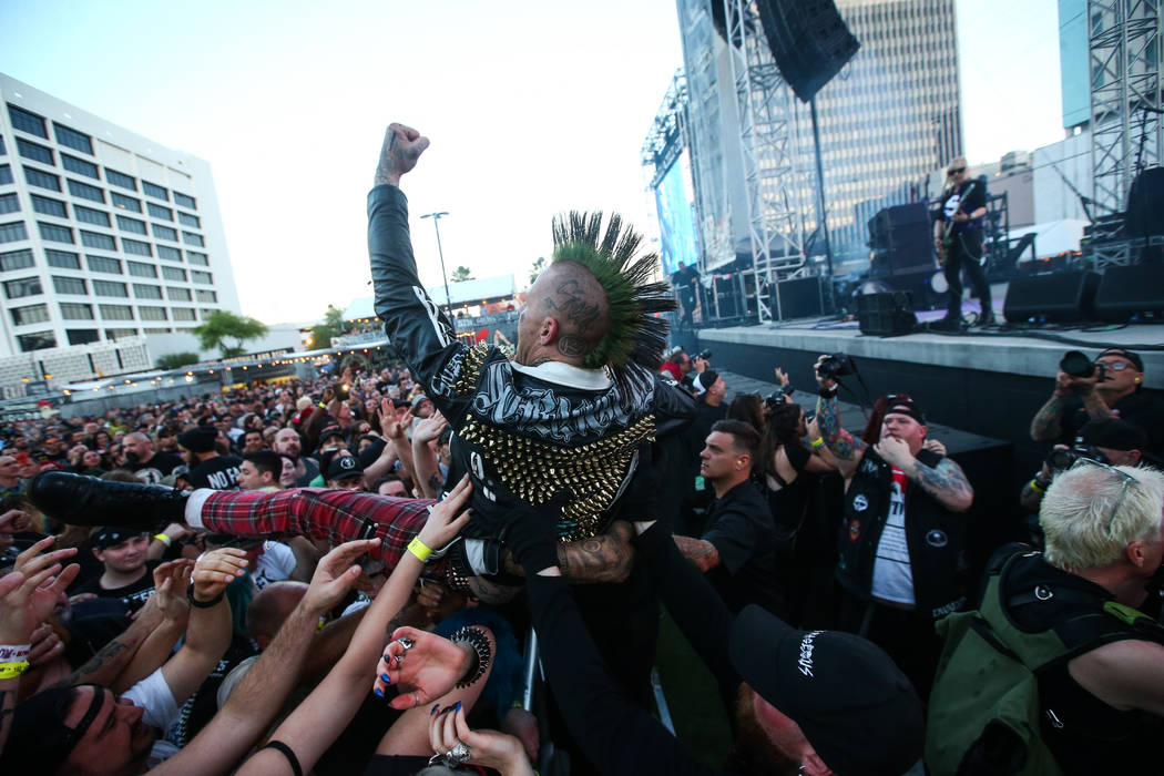 An attendee crowd surfs as L7 performs during the first day of the Punk Rock Bowling music fest ...