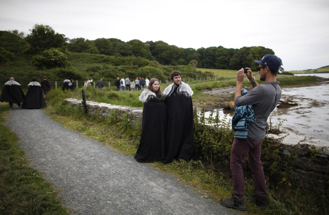 "FILE- In this June 13, 2014, file photo ""Game of Thrones"" fans stop for a picture on ..."
