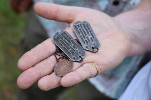 FILE - In this Aug. 3, 2017, file photo, the dog tags and a Hawaiian pressed penny charm of Pfc ...