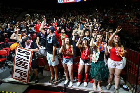 UNLV Rebels fans in the student section cheer during the second half of a basketball game again ...
