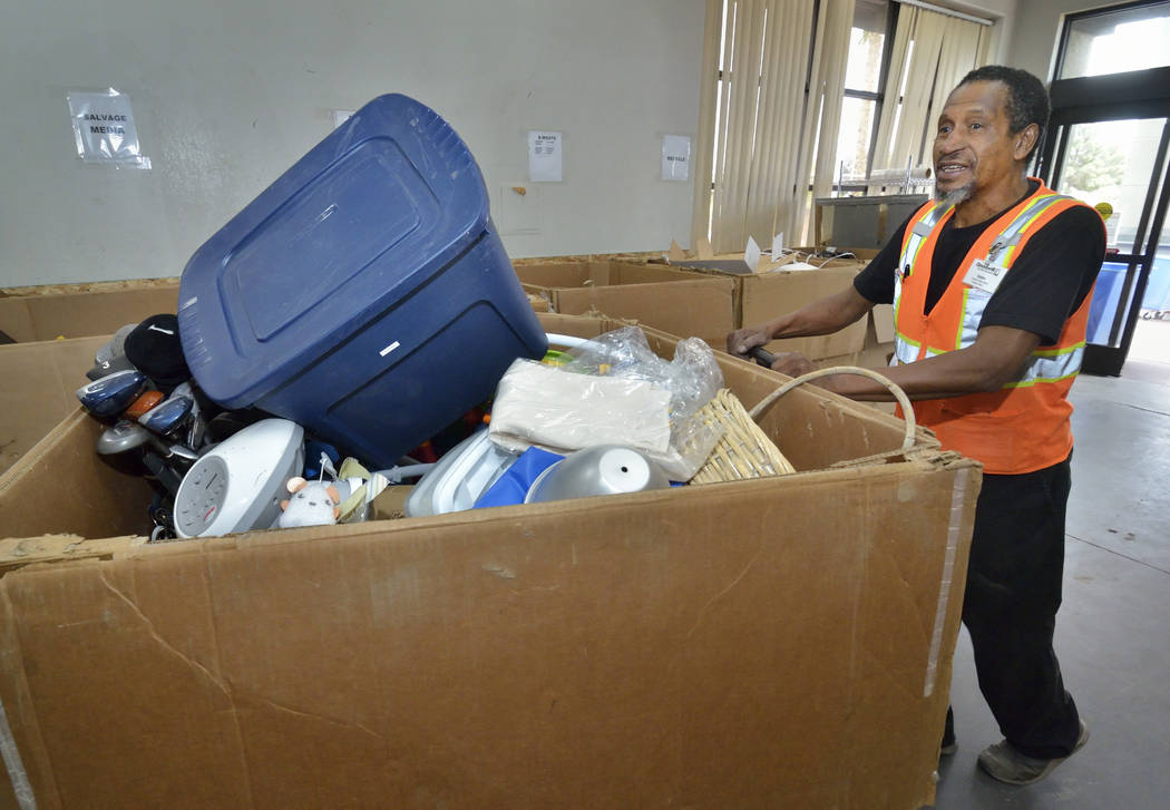 Donation attendant Ulysses Hampton moves merchandise in the warehouse at the Goodwill Thrift St ...