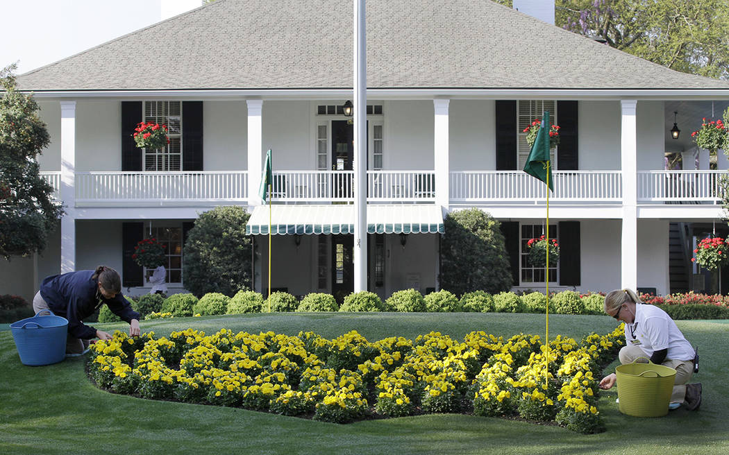 Michelle Stevens, left, and Anna Yeager manicure the flower bed in front of the clubhouse at th ...