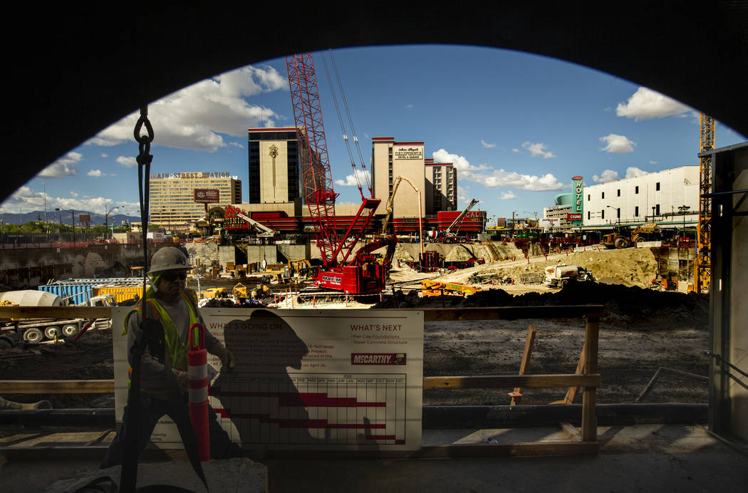 Construction continues at the under-development Circa viewed from a porthole in the Fremont exp ...