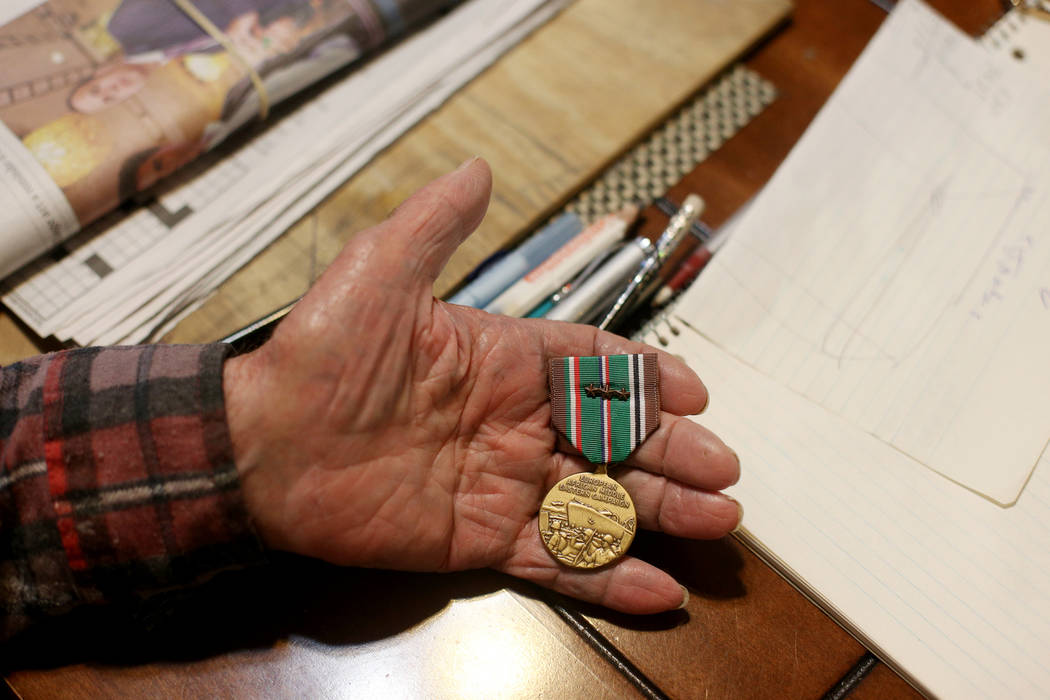 "Onofrio ""No-No"" Zicari, 96, shows the the Review-Journal a medal he earned for his th ..."