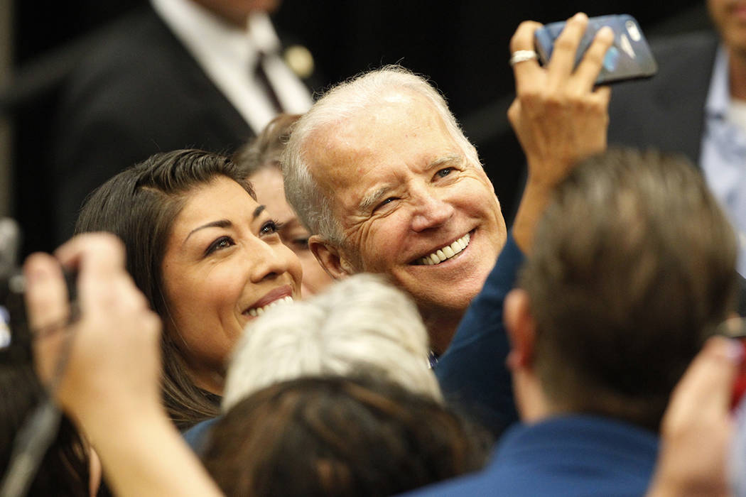 Lucy Flores, left, and Vice President Joe Biden take a photo together during a get out the vote ...