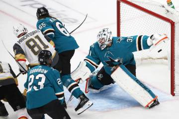 Knights center William Karlsson (71) scores against San Jose Sharks goaltender Martin Jones (31 ...