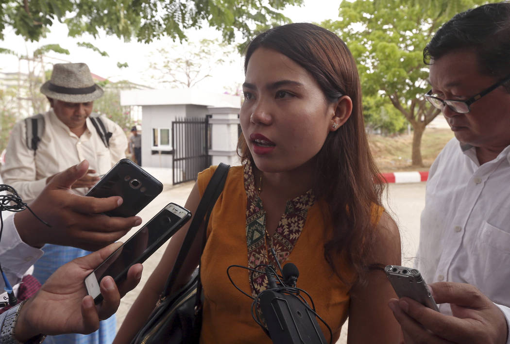 Chit Su Win, wife of Reuters journalist Kyaw Soe Oo, talks to journalists as she leaves the Sup ...