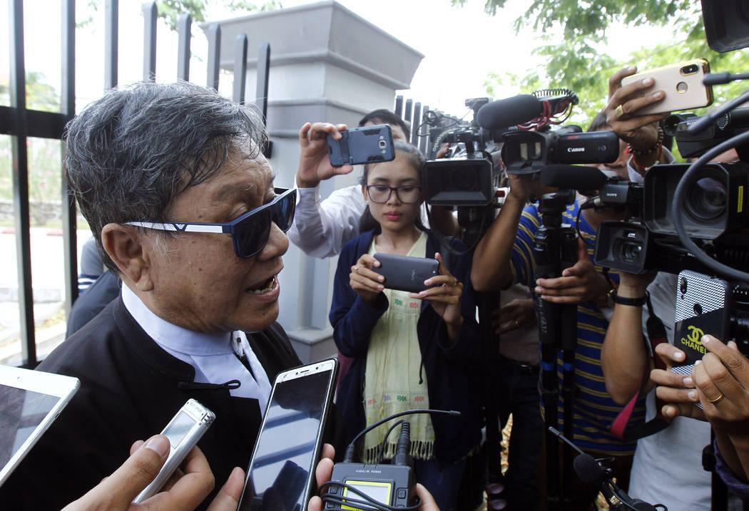 Khin Maung Zaw, a lawyer of two Reuters journalists, Wa Lone and Kyaw Soe Oo, talks to journali ...