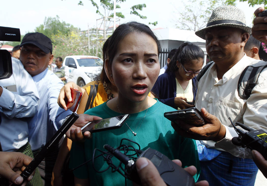 Pan Ei Mon, wife of Reuters journalist Wa Lone, talks to journalists as she leaves the Supreme ...