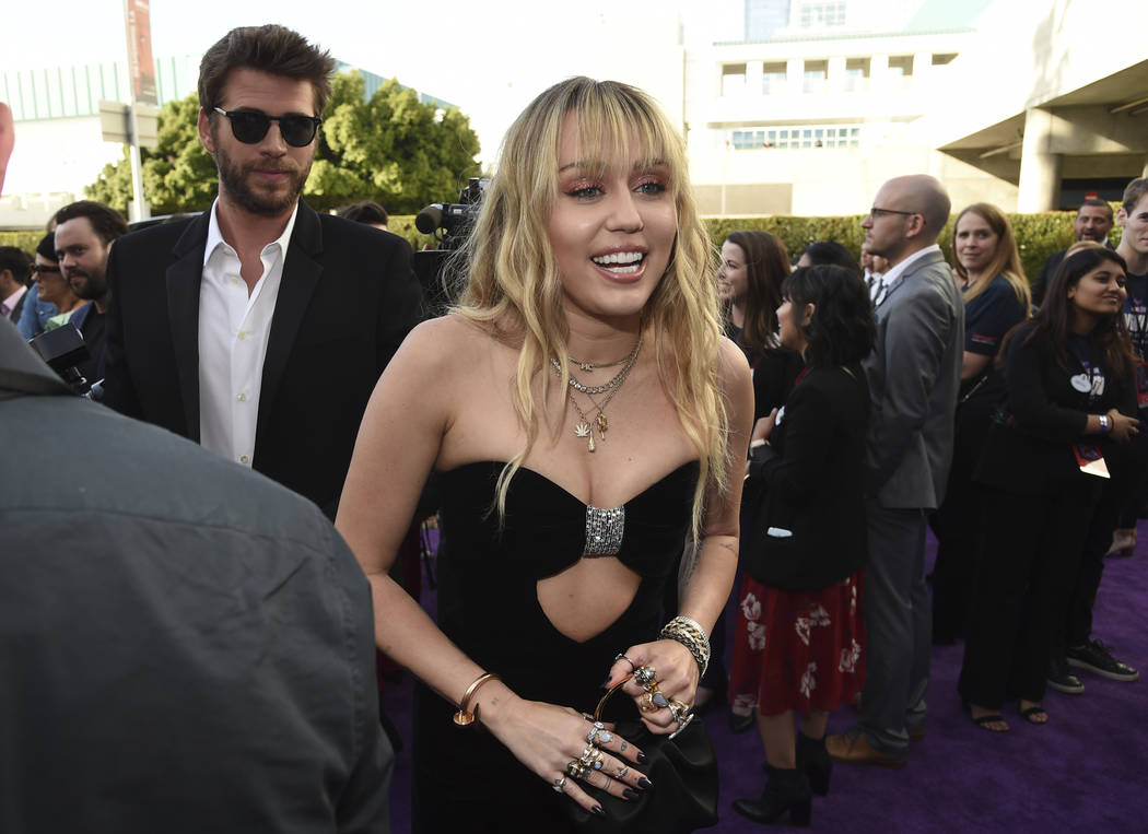 """Liam Hemsworth, left, and Miley Cyrus arrive at the premiere of """"Avengers: Endgame"""" a ..."""