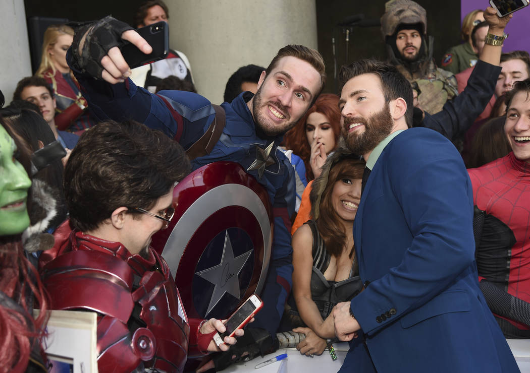 """Chris Evans takes a selfie with a fan as he arrives at the premiere of """"Avengers: Endgame& ..."""