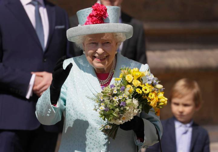Britain's Queen Elizabeth II waves to the public as she leaves after attending the Easter Matti ...