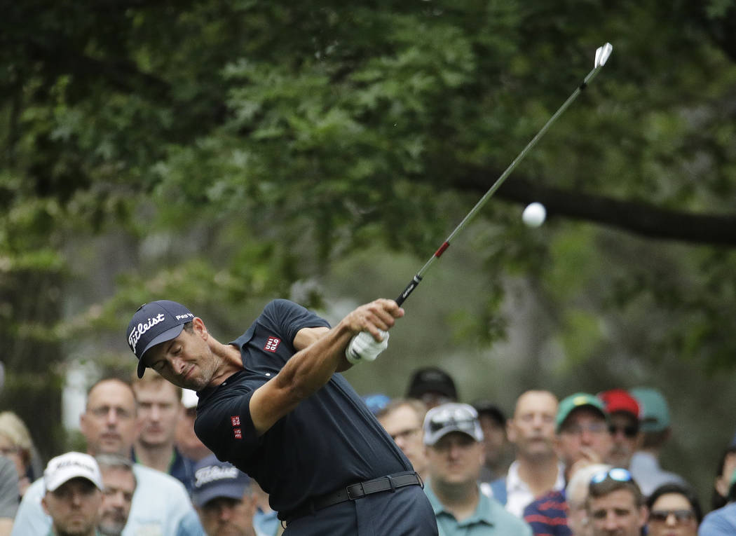 Adam Scott, of Australia, hits from the fourth tee during the final round for the Masters golf ...