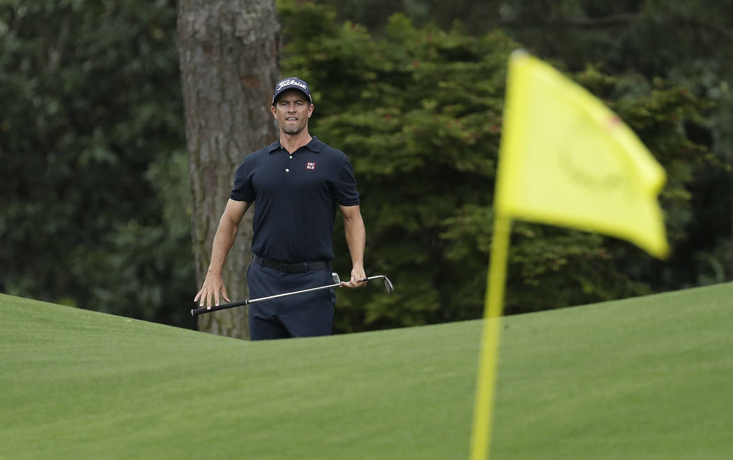 Adam Scott, of Australia, looks over a shot on the eighth hole during the final round for the M ...