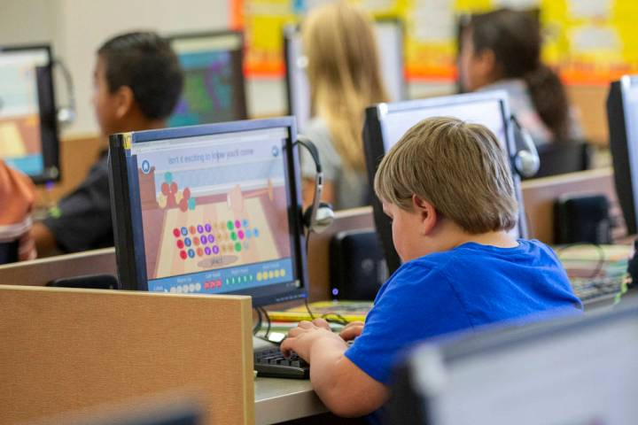 Students work on computers at an elementary school Oct. 29, 2018, in Beaver, Utah. According to ...
