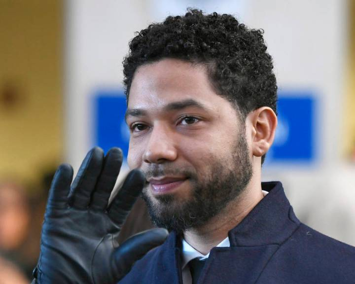 Actor Jussie Smollett smiles and waves to supporters March 26, 2019, before leaving Cook County ...