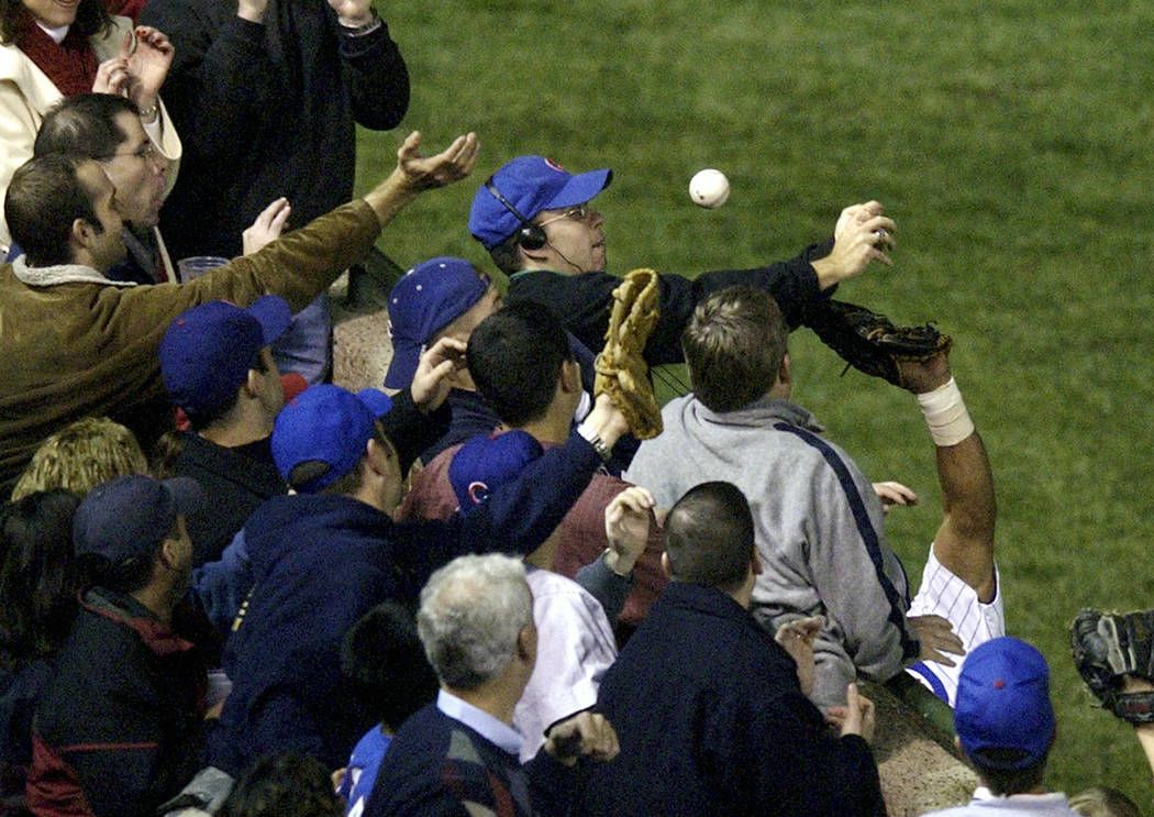 In this Oct 14, 2003 file photo, Steve Bartman catches a ball as Chicago Cubs left fielder Mois ...