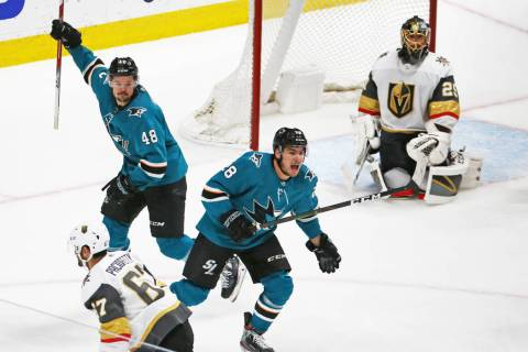 Sharks center Tomas Hertl (48) and Sharks right wing Timo Meier (28) celebrate after the Sharks ...