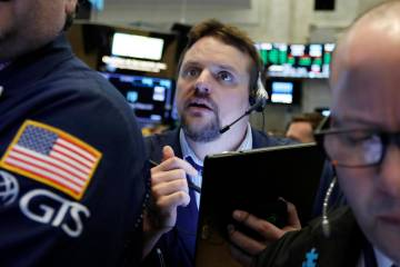 Trader Michael Milano works March 12, 2019, on the floor of the New York Stock Exchange. The U. ...