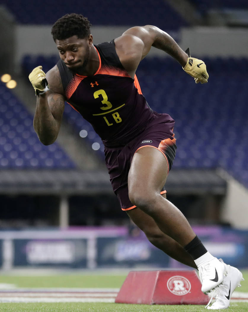 Kentucky linebacker Josh Allen runs a drill at the NFL football scouting combine in Indianapoli ...