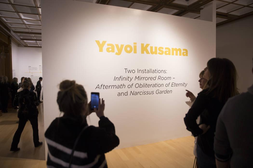 Attendees explore Yayoi Kusama's new exhibit at Bellagio Gallery of Fine Art on Friday, Nov. 16 ...