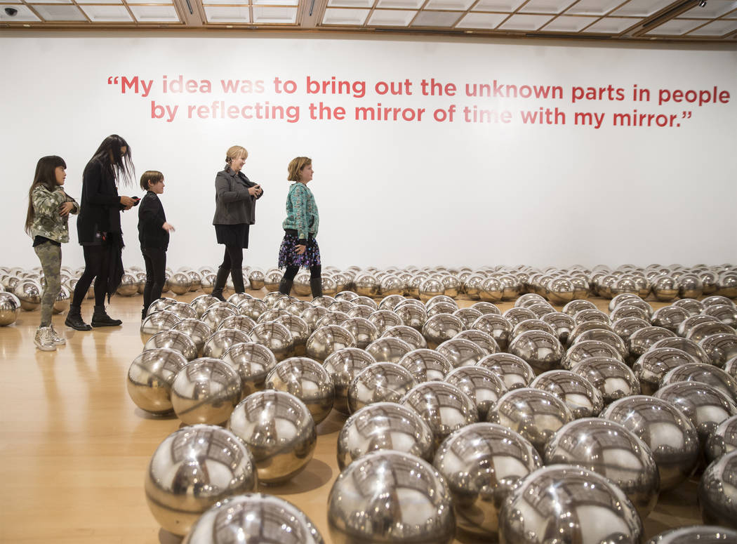 """Attendees walk through """"Aftermath of Obliteration of Eternity and Narcissus Garden"""" a ..."""
