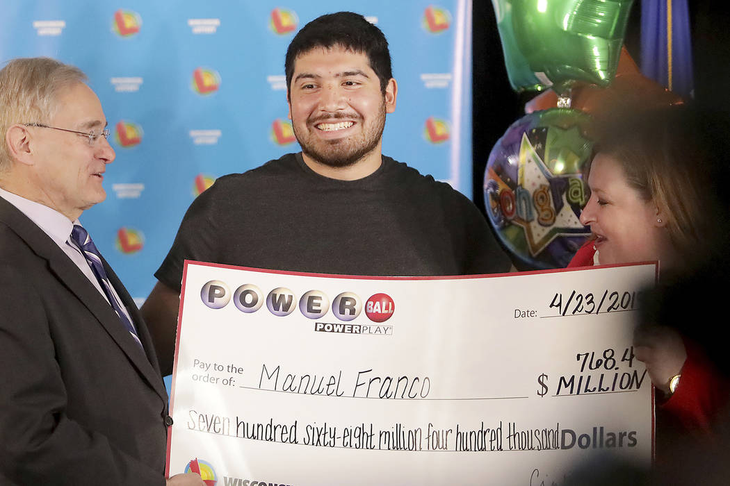 Manuel Franco of West Allis, Wis., winner of second-highest Powerball lottery in history, atten ...