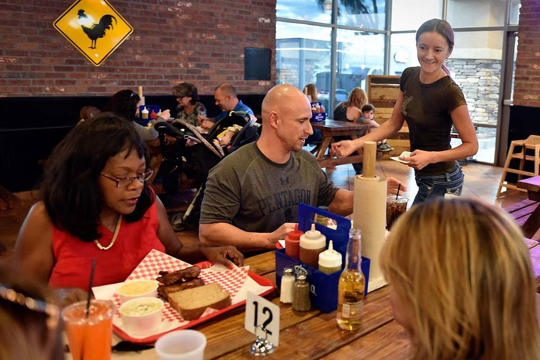 Owner Natalia Badzjo, right, checks on her customers at Big B's Texas BBQ in Henderson. (David ...