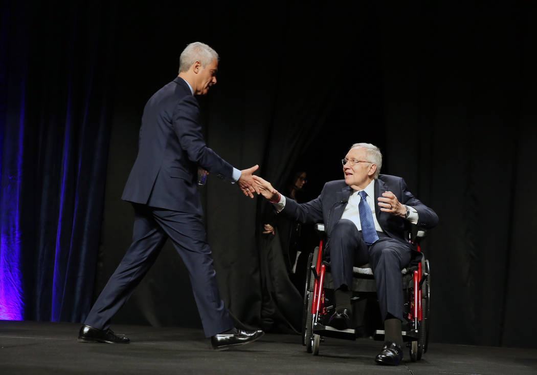 City of Chicago Mayor Rahm Emanuel, left, shakes hands with former U.S. Sen. Harry Reid prior t ...
