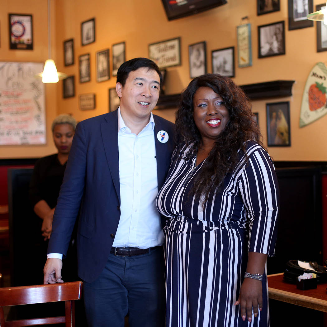 Democratic presidential candidate Andrew Yang, left, takes a photo with Shannon Churchwell, cha ...