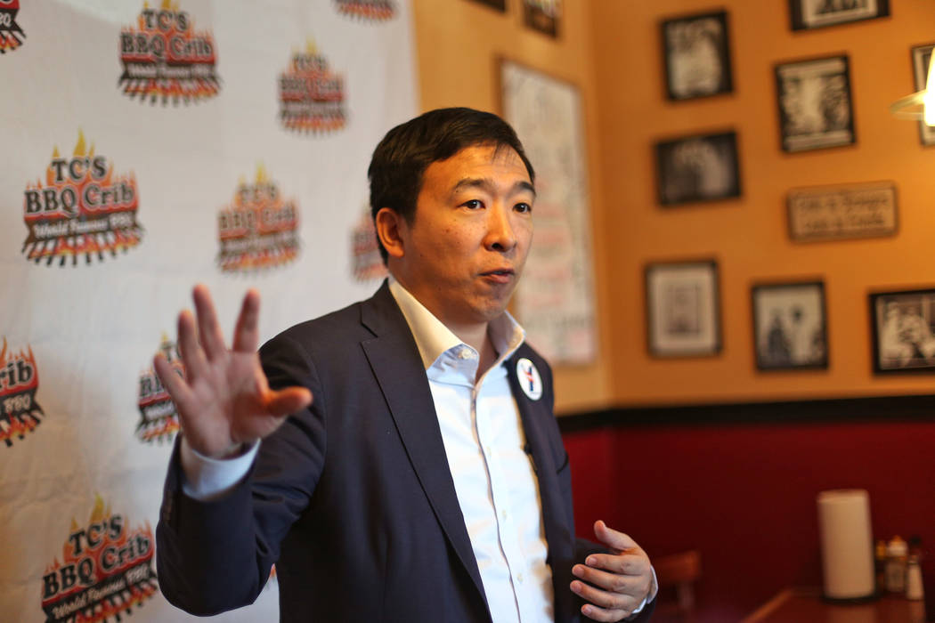 Democratic presidential candidate Andrew Yang addresses a room of parents of the black Arbor Vi ...