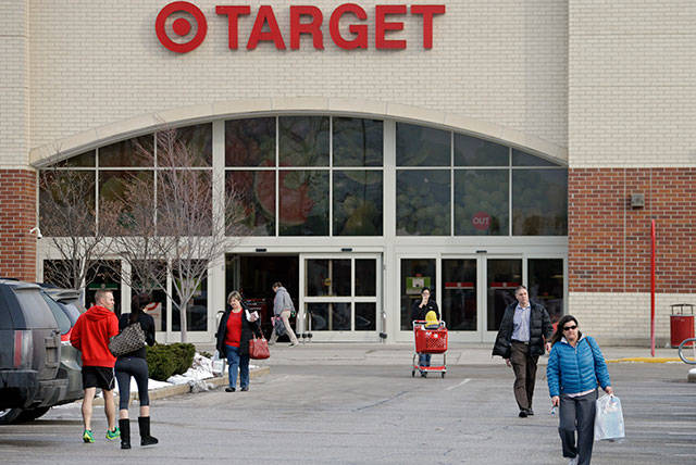 Customers exit a Target store. (AP Photo file)
